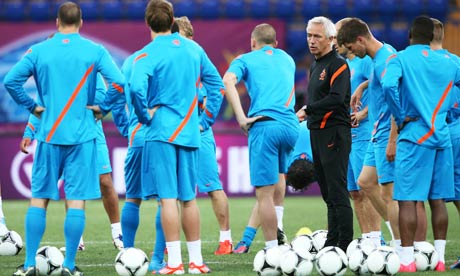 Holland manager Bert van Marwijk addresses his players