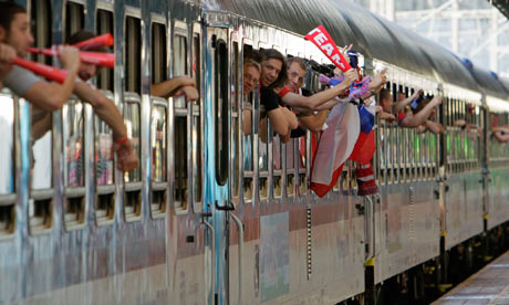 Czech fans cheer before their departure from Prague's main railway station to Warsaw