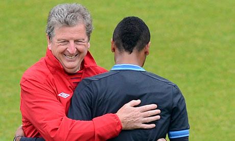 Roy Hodgson pats Ashley Cole on the back
