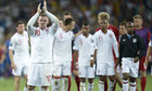 English forward Wayne Rooney (L) waves a