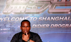 Didier Drogba listens to a reporter's question during a press conference in Shanghai