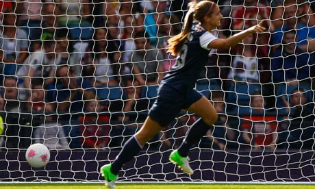 Alex Morgan celebrates after scoring