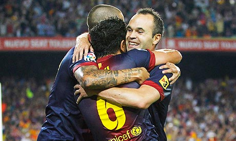 Barcelona's Xavi Hernandez, centre, celebrates with a group hug after scoring against Real Madrid