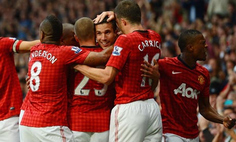 Robin van Persie is congratulated after scoring