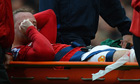 Wayne Rooney is stretchered off