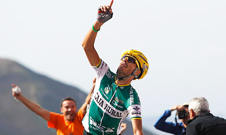 Caja Rural rider Antonio Piedra of Spain points to the sky as he crosses the finish line
