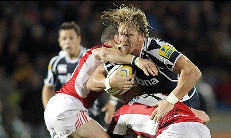 Andy Powell of Sale Sharks is blocked by London Welsh