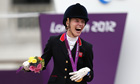 Great Britain's Sophie Christiansen celebrates her gold medal