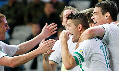Ireland's Robbie Keane, second right, celebrates his spot kick