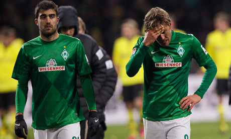 Werder Bremen's Clemens Fritz and Sokratis leave the pitch after the 5-0 defeat