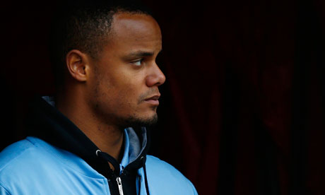 Vincent Kompany watches on after going off injured in the win at Stoke - Vincent-Kompany-watches-o-008