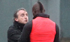 Man City manager Roberto Mancini and Mario Balotelli tussle