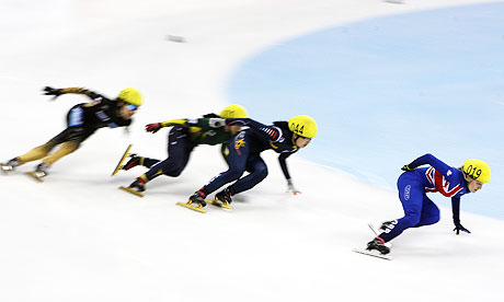 EGreat Britain's Elise Christie, right, leads the way