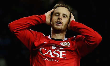 MK Dons' Ryan Harley shows his disappointment during the FA Cup tie at Sheffield Wednesday