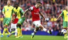 Arsenal's Jack Wilshere scores the first goal against Norwich City in the Premier League
