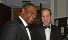 Fifa vice-president Jeffrey Webb, left, talking to Prince William at the FA 150th anniversary dinner