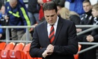 Malky Mackay looks at his watch before the Southampton game