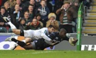 Leicester wing Miles Benjamin dives for his second try despite Montpellier's Jonathan Pélissié