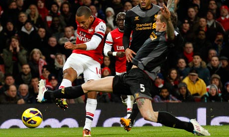 Theo Walcott scores against Liverpool