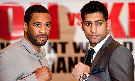 Lamont Peterson with Britain's Amir Khan