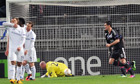 Tottenham Hotspur players show their dejection after Lyon scored in the Europa League
