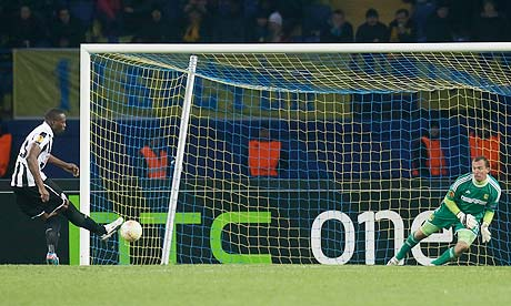 Shola Ameobi of Newcastle United scores a penalty against Metalist Kharkiv in the Europa League