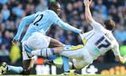 Yaya Touré get stuck into Leeds' Michael Brown
