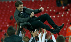 Michael Laudrup is tossed into the air at Wembley
