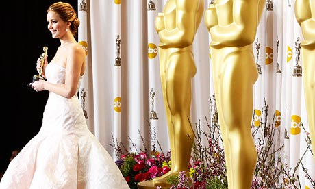 Jennifer Lawrence poses with her Oscar