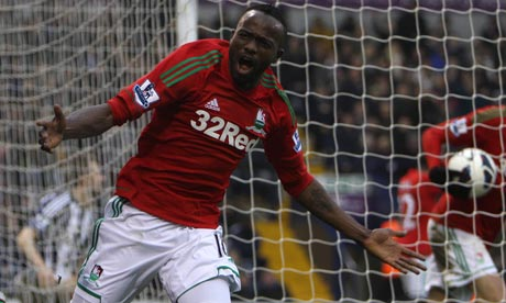 Swansea City's Roland Lamah celebrates an 'equaliser' at West Bromwich Albion