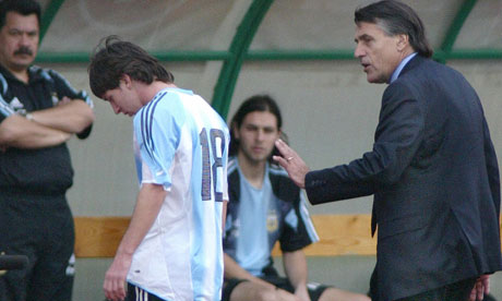 Lionel Messi is comforted by coach Jose Pekerman after being sent off on his international debut