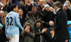 Manchester City's Carlos Tevez with Roberto Mancini at the FA Cup tie against Barnsley