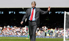 Arsène Wenger walks along the touchline at Craven Cottage
