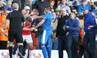 Lee Vaughan of Kidderminster Harriers is attacked by a Stockport County fan