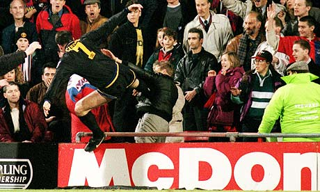 Manchester United's Eric Cantona launches his infamous kung fu against a Crystal Palace fan in 1995