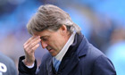 Roberto Mancini, the Manchester City manager, cut a troubled figure after defeat in the FA Cup final