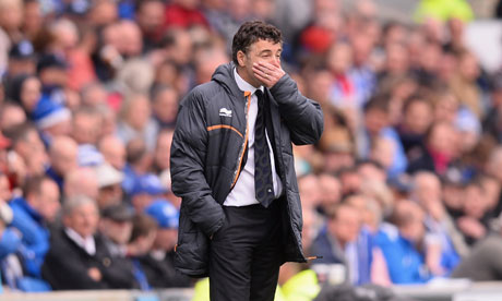 A dejected Dean Saunders looks on during the defeat at Brighton on day that Wolves were relegated