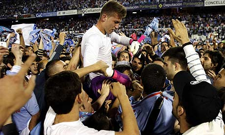 Celta Vigo's goalkeeper Ruben Blanco celebrates with supporters