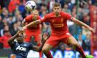 Steven Gerrard vies with Danny Welbeck