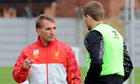 Liverpool's Brendan Rodgers talks to Steven Gerrard