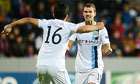 Manchester City's Edin Dzeko, right, celebrates with Sergio Agüero after scoring at Viktoria Plzen