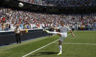 Gareth Bale kicks a ball to the fans during his presentation as a new Real Madrid player