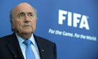 President of FIFA, Joseph Blatter, gives
