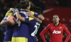 Swansea celebrate as Chris Smalling watches on
