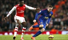 Danny Welbeck of Arsenal, left, and Manchester United's Wayne Rooney
