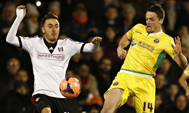 Fulham's Muamer Tankovic (L) challenges Sheffield United's Stephen McGinn
