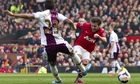 Manchester United's Juan Mata, right, scores against Aston Villa in the Premier League at Old Traffo