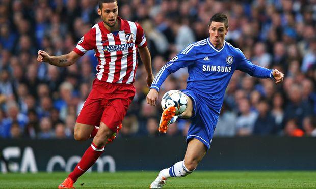 Mario Suárez of Atlético de Madrid closes down Fernando Torres of Chelsea.