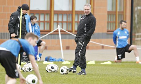 Rangers' manager Ally McCoist, right, watches his players during a training session ahead of the Ram