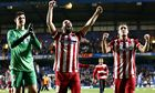 Thibaut Courtois, Arda Turan and Koke celebrate